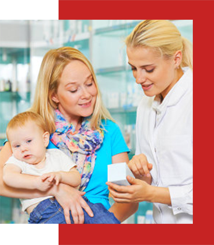 a mother carrying her child talking to a pretty pharmacist