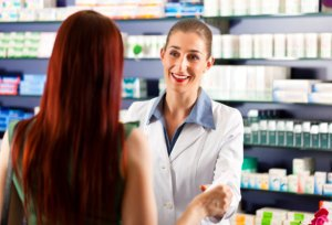 pharmacist negotiating to a customer